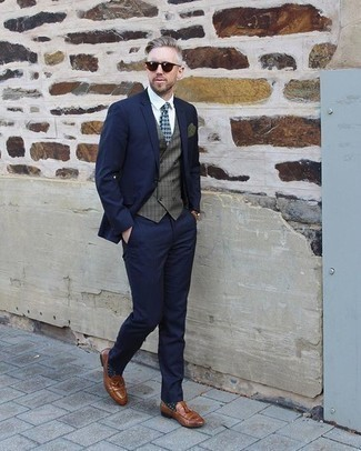 How To Wear a Waistcoat With Tassel Loafers: This combo of a waistcoat and a navy suit spells rugged refinement. Finishing off with a pair of tassel loafers is a surefire way to inject a more relaxed touch into this outfit.
