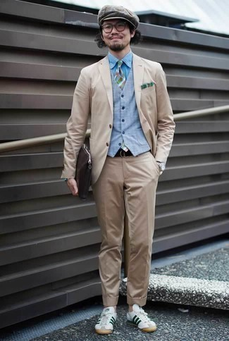How to Wear a Light Blue Waistcoat: Go all out in a light blue waistcoat and a beige suit. And if you wish to easily tone down this look with one piece, add a pair of white and green leather low top sneakers to the mix.