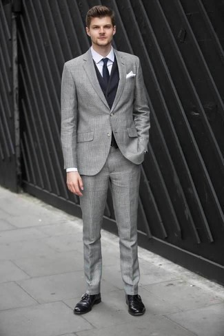 How to Wear a Grey Plaid Suit: You're looking at the indisputable proof that a grey plaid suit and a navy waistcoat are awesome together in a refined ensemble for a modern dandy. Let your styling skills really shine by finishing off your ensemble with a pair of black leather monks.
