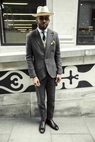 How to Wear a Beige Waistcoat: This combination of a beige waistcoat and a grey vertical striped suit is ideal when you need to look truly stylish. Switch up this outfit by sporting a pair of burgundy leather oxford shoes.