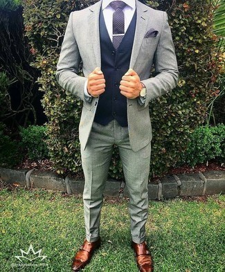 How to Wear a Navy and White Polka Dot Tie For Men: Choose a grey suit and a navy and white polka dot tie to ooze class and refinement. Finishing with brown leather double monks is a surefire way to introduce a sense of stylish nonchalance to this ensemble.