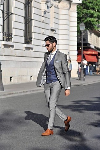 How to Wear a Navy Waistcoat: This combo of a navy waistcoat and a grey suit will add powerful essence to your ensemble. Make this look current by finishing with a pair of tobacco leather double monks.