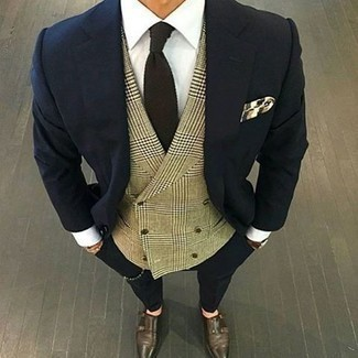 How to Wear Dark Brown Leather Double Monks: A navy suit and a tan plaid waistcoat are among the basic elements of a refined wardrobe. A pair of dark brown leather double monks adds a new flavor to an otherwise mostly dressed-up getup.