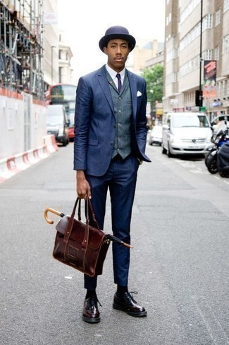 How To Wear a Suit With Brogues: This pairing of a suit and a blue waistcoat is really stylish and creates instant appeal. For something more on the cool and casual side to complete this ensemble, introduce a pair of brogues to the equation.
