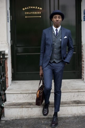 How To Wear a Suit With Brogues: Consider wearing a suit and a navy waistcoat to look like a real gent. Finishing off with a pair of brogues is a surefire way to bring a more laid-back aesthetic to your getup.