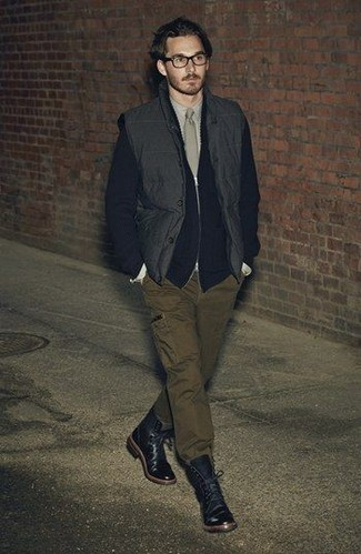 How to wear: olive cargo pants, beige dress shirt, black zip sweater, black gilet