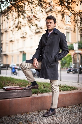 How to wear: beige chinos, pink dress shirt, navy zip sweater, black raincoat