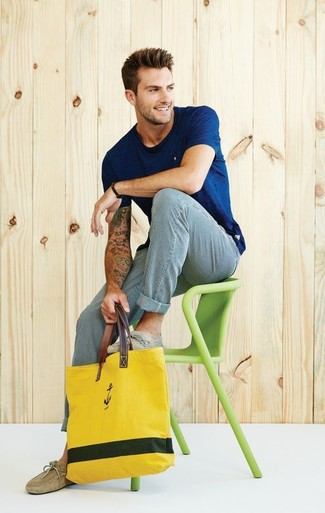 How to wear: yellow canvas tote bag, tan suede driving shoes, white and blue vertical striped chinos, navy crew-neck t-shirt