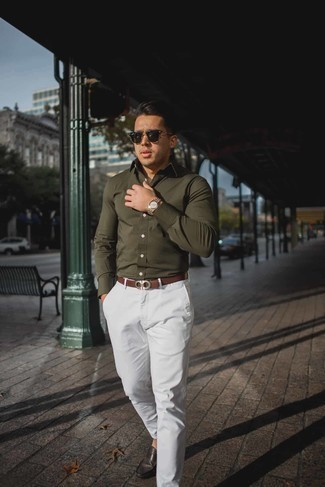 How to Wear White Chinos: This combination of an olive long sleeve shirt and white chinos is solid proof that a pared down off-duty outfit doesn't have to be boring. Now all you need is a good pair of dark brown leather driving shoes.
