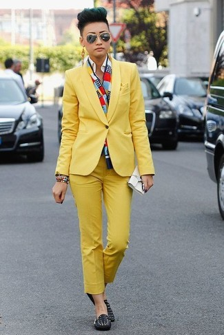 How to wear: white leather clutch, black studded leather driving shoes, white dress shirt, yellow suit
