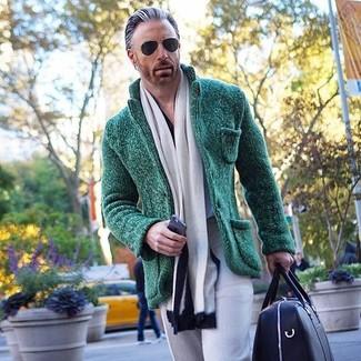 How to wear: white and black scarf, black leather duffle bag, grey dress pants, dark green knit blazer