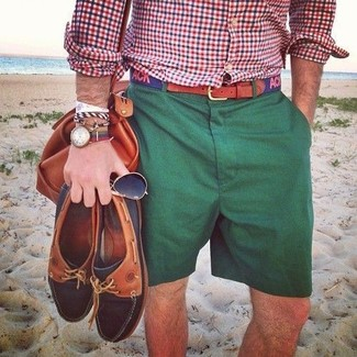 How to wear: navy print canvas belt, tobacco leather duffle bag, dark green shorts, white and red and navy gingham long sleeve shirt