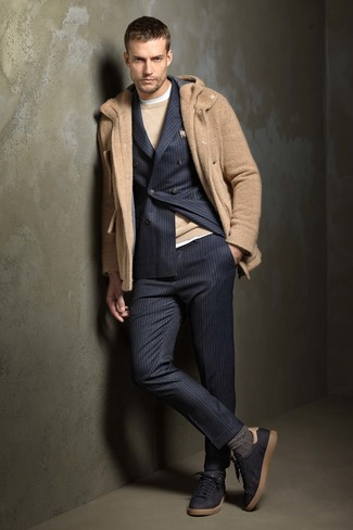 How to wear: camel duffle coat, navy vertical striped suit, tan crew-neck sweater, white crew-neck t-shirt