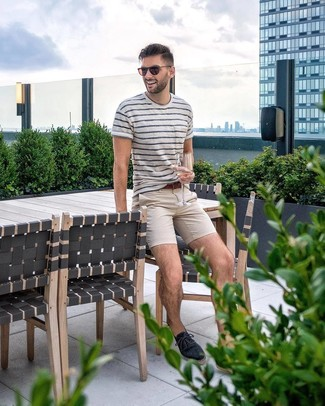 How to wear: brown leather belt, navy canvas espadrilles, beige chinos, white and navy horizontal striped crew-neck t-shirt