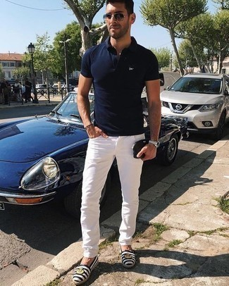 How to Wear a Navy Polo For Men: Showcase your skills in men's fashion in this casual combination of a navy polo and white jeans. White and black horizontal striped canvas espadrilles are a wonderful pick to finish this outfit.