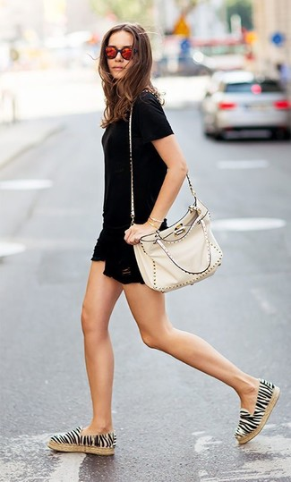 How to wear: beige studded leather crossbody bag, white and black horizontal striped espadrilles, black ripped denim shorts, black crew-neck t-shirt