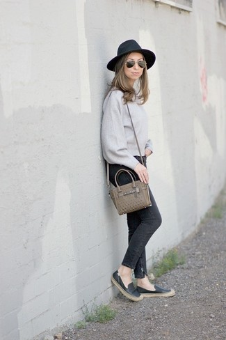 How To Wear Skinny Jeans With Espadrilles: A grey crew-neck sweater and skinny jeans are absolute essentials if you're crafting a casual wardrobe that matches up to the highest style standards. Introduce a pair of espadrilles to the equation to infuse a dash of casualness into this look.