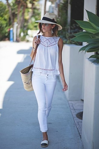 How to wear: beige straw tote bag, white and black espadrilles, white skinny jeans, white crochet sleeveless top