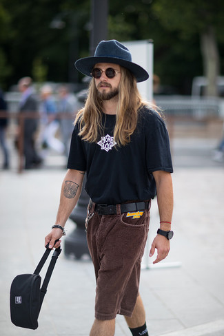How to wear: navy wool hat, black canvas fanny pack, dark brown corduroy shorts, black and white print crew-neck t-shirt