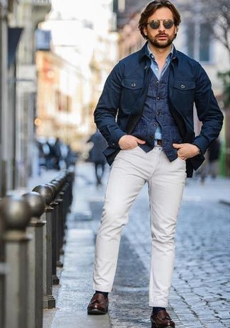 How to wear: navy field jacket, navy denim waistcoat, light blue chambray long sleeve shirt, white chinos