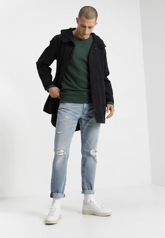 How to wear: black fishtail parka, dark green sweatshirt, light blue ripped jeans, white leather low top sneakers