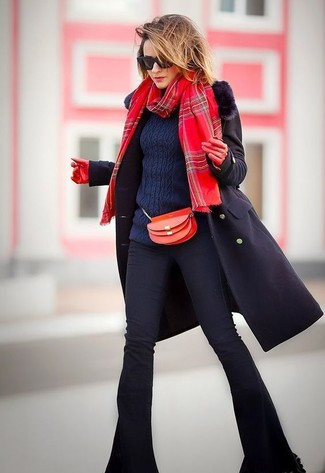 How to wear: red leather crossbody bag, black flare jeans, navy cable sweater, black fur collar coat