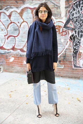 How to Wear a Black Cami Dress: This combo of a black cami dress and light blue flare jeans is the perfect foundation for a multitude of ensembles. Complement this outfit with white and black leather ankle boots and the whole getup will come together wonderfully.