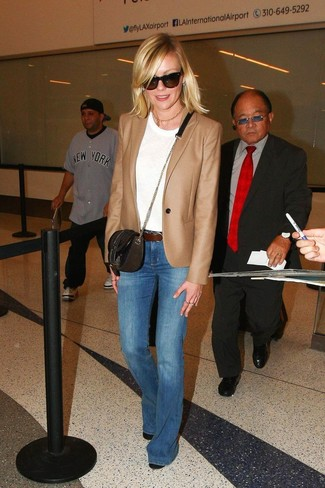 How to Wear a Tan Blazer For Women: Marry a tan blazer with blue flare jeans to put together an absolutely chic and modern-looking casual outfit. If not sure as to what to wear when it comes to footwear, go with black leather ankle boots.