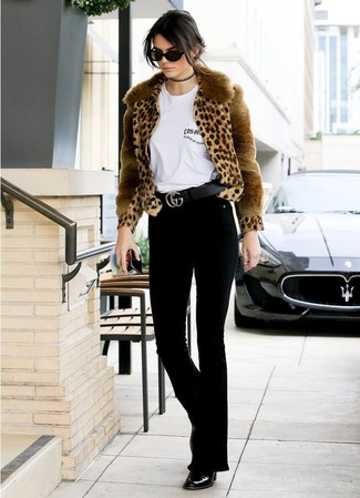 How to wear: black leather ankle boots, black flare jeans, white crew-neck t-shirt, tan leopard fur jacket