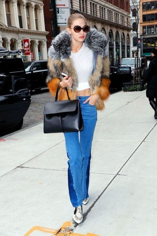 How to wear: grey snake leather ankle boots, blue flare jeans, white crew-neck t-shirt, brown fur jacket