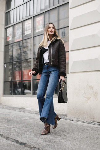 How to wear: brown snake leather ankle boots, blue flare jeans, white crew-neck t-shirt, dark brown shearling jacket