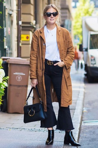 How to wear: black leather ankle boots, black flare jeans, white crew-neck t-shirt, brown suede trenchcoat