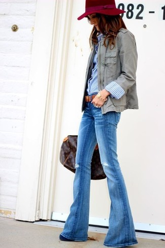 How to wear: navy suede pumps, blue flare jeans, blue vertical striped dress shirt, grey military jacket