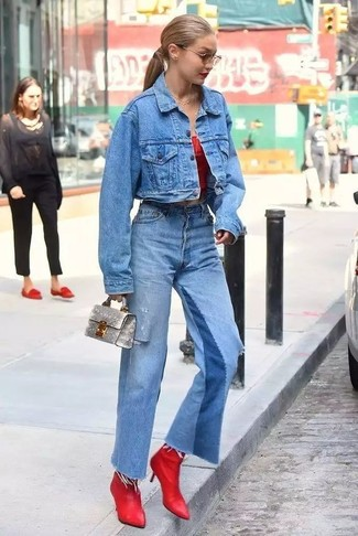 How to wear: red leather ankle boots, blue flare jeans, red off shoulder top, blue denim jacket