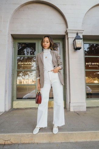 How to Wear a Tan Blazer For Women: This combination of a tan blazer and white flare jeans is hard proof that a straightforward casual ensemble doesn't have to be boring. A pair of white leather loafers is a smart choice to finish your look.