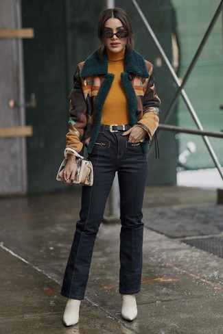 How to wear: white leather ankle boots, navy flare jeans, mustard turtleneck, multi colored shearling jacket