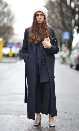 How to wear: silver sequin pumps, black flare pants, navy double breasted blazer, black coat