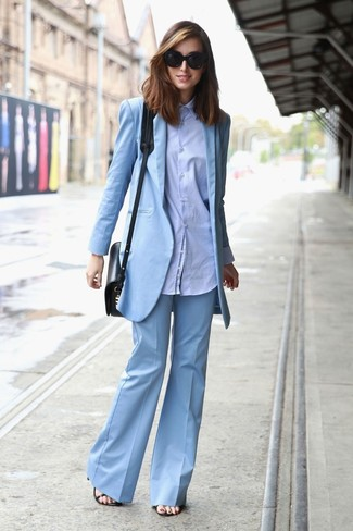 How to wear: black leather heeled sandals, light blue flare pants, light blue dress shirt, light blue blazer