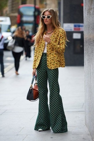 How to wear: white leather pumps, dark green floral flare pants, white tank, yellow floral blazer