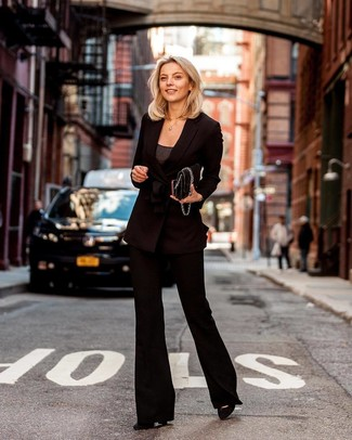 Fashion for 30 Year Old Women: What To Wear: If the situation permits an off-duty look, you can easily go for a black double breasted blazer and black flare pants. The whole getup comes together if you complement your outfit with a pair of black suede pumps.