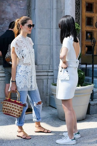 How to wear: tan straw handbag, dark brown embellished leather flat sandals, light blue ripped boyfriend jeans, white lace tunic