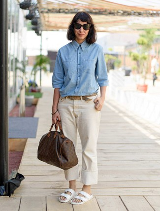 How to wear: dark brown print leather duffle bag, white leather flat sandals, beige jeans, light blue chambray dress shirt