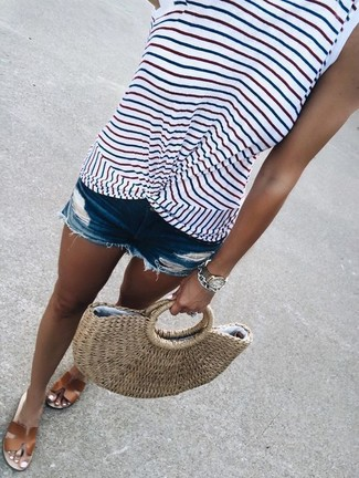 How to wear: tan straw tote bag, brown leather flat sandals, blue ripped denim shorts, white horizontal striped tank