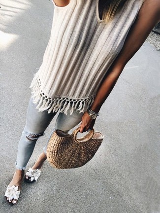 How to wear: tan straw tote bag, white floral canvas flat sandals, light blue ripped skinny jeans, white knit tank