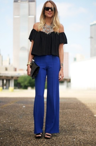 How to Wear Blue Wide Leg Pants: A black pleated off shoulder top and blue wide leg pants are the kind of a no-brainer casual outfit that you so awfully need when you have no extra time to spare. Why not complement your look with black leather flat sandals for an element of playfulness?