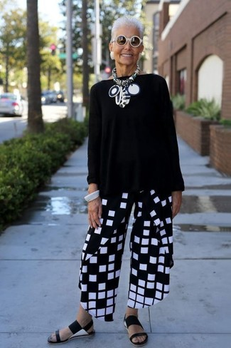 How to wear: white sunglasses, black leather flat sandals, black and white check wide leg pants, black oversized sweater