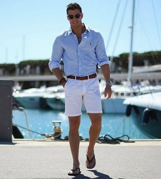 How to wear: dark brown leather belt, black flip flops, white shorts, light blue long sleeve shirt