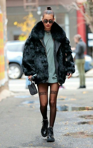 How to wear: black fur coat, mint crew-neck t-shirt, black leather boots, black sunglasses