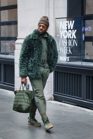 How to wear: dark green fur coat, olive long sleeve shirt, olive chinos, olive suede high top sneakers