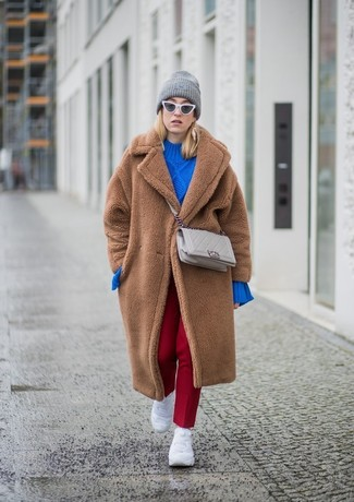 Consider teaming a brown fur coat with a grey beanie for a stylish and sophisticated look. Opt for a pair of white athletic shoes to make the ensemble more current. As you might be rightly thinking, this is also a knockout pick come spring.